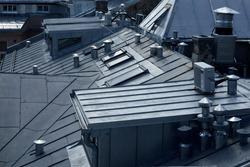 Architectural detail of metal roofing on commercial construction of modern building complex. High quality photo