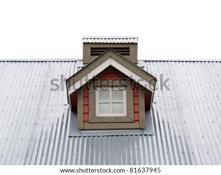 Architectural detail of small dormer window in metal sheet roof of residential house.