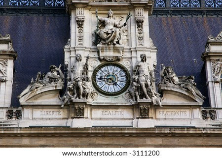 Architectural Details With Sculptures And Clock Hotel De