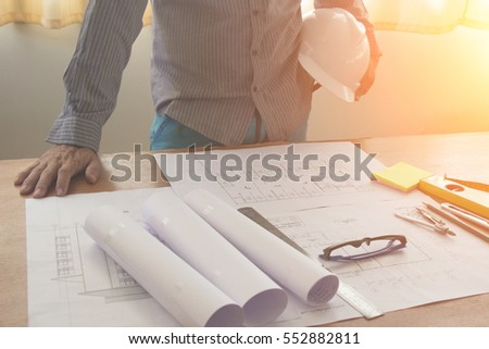Architectural Office desk background construction project ideas concept, With drawing equipment with sunlight at morning #552882811