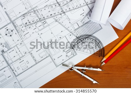 Architectural plans, pencils and ruler on the desk