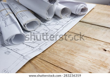 Architectural project, blueprints, blueprint rolls on vintage wooden background. Construction concept. Engineering tools top view. Copy space Сток-фото ©