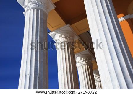 architecture, classical columns against blue sky, horizontal