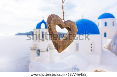 Architecture detail  in town Oia. Santorini Greece. Wooden heart on church background