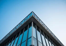 Architecture detail Modern Building Glass facade Corner Blue sky Background