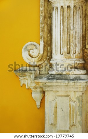 Architecture detail of column over yellow wall