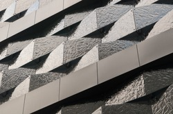 Architecture details wall pattern modern geometric abstract facade of triangles with metal lines background