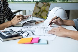 Architecture Engineer Teamwork Meeting, Drawing and working for architectural project and engineering tools on workplace, concept of work on technical drawings.