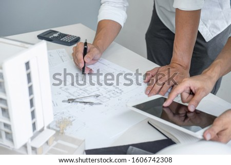 Architecture Engineer Teamwork Meeting, Drawing and working for architectural project and engineering tools on workplace, concept of worksite on technical drawing structure and construction. Stockfoto ©