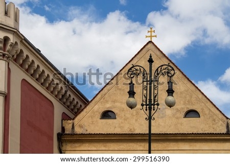 Architecture in Prague\ Traditional european architecture in the capital of Czech Republic, Prague. Cloudy sky.
