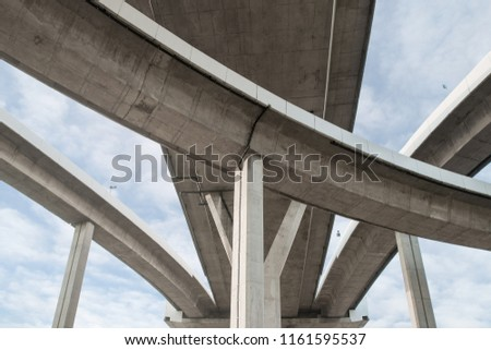 Architecture lines under the bridge, Elevated expressway,The curve of bridge in Bangkok, Thailand. #1161595537