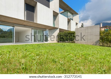 Architecture, new trend design, external of a modern house with garden