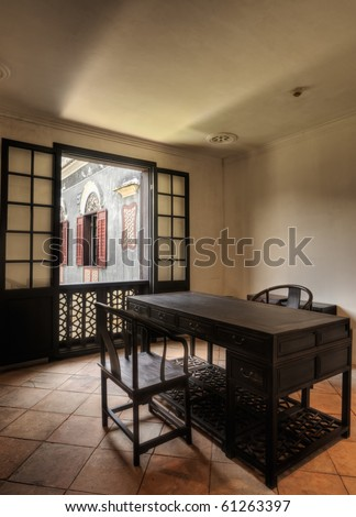 Architecture of Chinese room, interior with wooden chair and desk and windows.