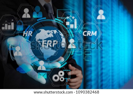 Architecture of ERP (Enterprise Resource Planning) system with connections between business intelligence (BI), production, CRM modules and HR diagram.businessman hand holding cloud network icon.