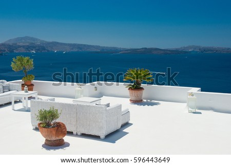 Architecture of island of Santorini, the most romantic island in the world, Greece.  Travel to Greece. Beautiful white exterior Santorini. Terrace with sea view #596443649