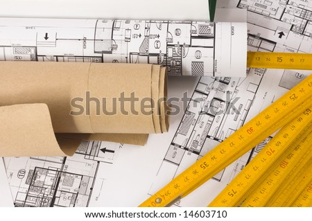 Architecture planning of interiors with wooden metre - stock photo