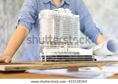 Shutterstock architecture show her model Simulate on blueprint architectural concept, soft focus