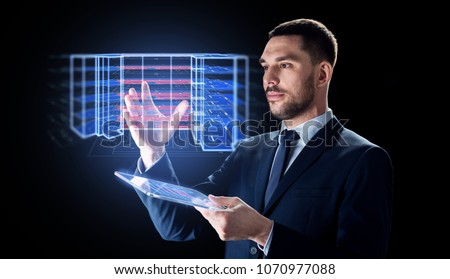 architecture, technology and construction concept - businessman with transparent tablet pc computer and virtual building blueprint projection
