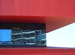 Architecture Vivid Red Building with White Apartments reflection in the Glass