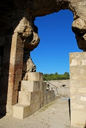 Archway into the Roman Amphitheatre at Italica, Seville, Seville Province, Andalucia, Spain.
