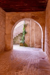 Archway to the internal backyard with no people in Sos del Rey Catolico downtown, Aragon, Spain