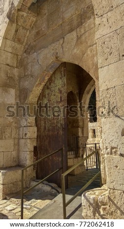 Archway vaulted with old white stones in old city of Jerusalem Tower of David #772062418