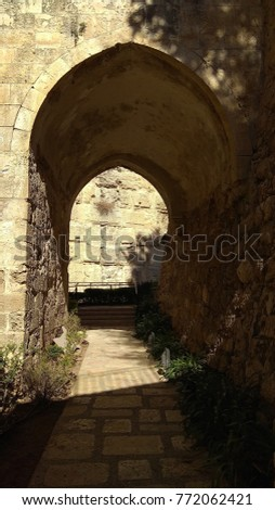 Archway vaulted with old white stones in old city of Jerusalem Tower of David #772062421