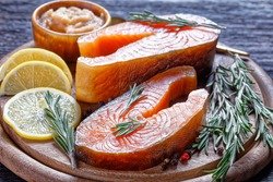 Arctic char and cod roe on a wooden background