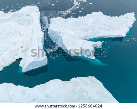 Arctic Iceberg on Arctic Ocean, Greenland #1258684024