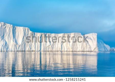 Arctic Icebergs on Arctic Ocean in Greenland #1258215241