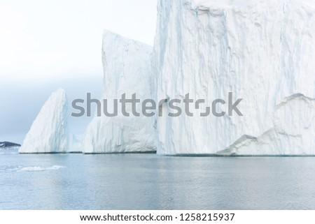 Arctic Icebergs on Arctic Ocean in Greenland #1258215937
