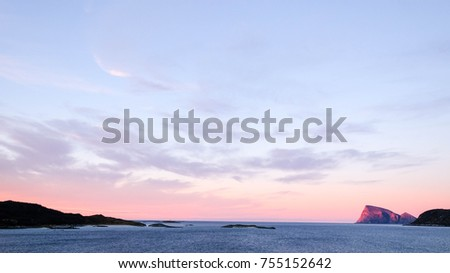 Arctic landscape, Skyline Aerial View with sundown sky and sea.