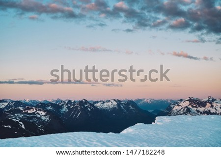 Arctic midnight sun view of Moon and mountains. Tromsdalstinden summit, Tromso, Norway