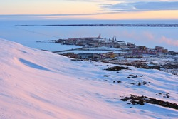 Arctic settlement. Pevek is the northernmost city in Russia. Cold snowy May in the Arctic in the north of Chukotka. Small polar town and the coast of the Arctic Ocean. Pevek, Chukotka, Siberia, Russia