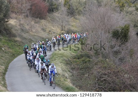 "ARDECHE, FRANCE - FEB 24: Professional racing cyclists pack riding UCI Europ TOUR ""LES BOUCLES DU SUD ARDECHE"". Matthieu Drujon wins the race on February 24, 2013 in Sampzon Rock, Ardeche, France."