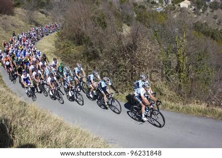 "ARDECHE, FRANCE - FEB 26: Professional racing cyclists riding UCI Europ TOUR ""LES BOUCLES DU SUD ARDECHE"". Remi Pauriol wins the race on February 26, 2012 in Sampzon Rock, Ardeche, France."