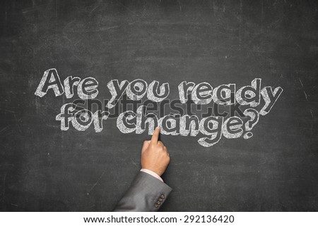 Are you ready for change concept on black blackboard with businessman hand