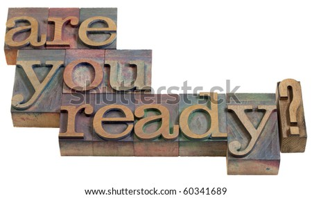 Are you ready question - vintage wooden letterpress printing blocks, stained by color inks, isolated on white
