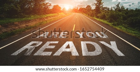 Are you ready written on highway road in the middle of empty asphalt road at  beautiful blue sky. Foto d'archivio ©