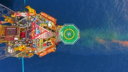 Areal photography from top view of jack up rig scenery with blue ocean view.
