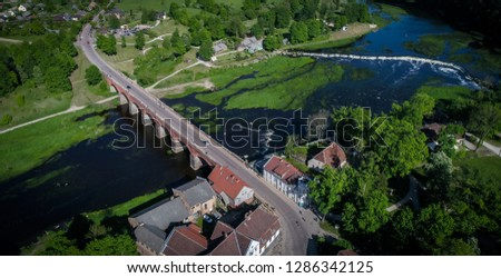 Areal view of The old brick bridge across the Venta river in Kuldiga, Latvia ,the longest bridge of this kind of road bridge in Europe built in 1874 , and Venta rapid in the background