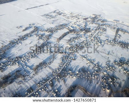 Areal view of Ukraine in winder from the window of the airplane #1427650871