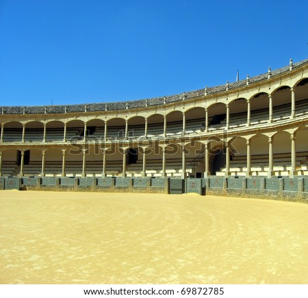 Arena sunny Spain where he plays the spectacle of the bullfight with angry bulls