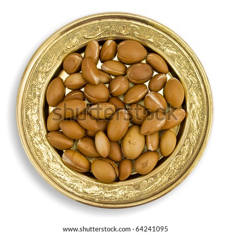 Argan fruits, on a golden dish