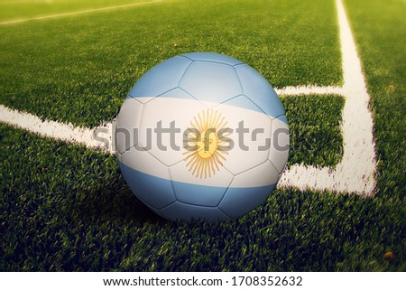 Argentina flag on ball at corner kick position, soccer field background. National football theme on green grass. ストックフォト ©
