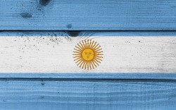Argentina flag painted on old wood plank background. Wooden texture background flag of Argentina.