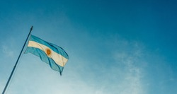 Argentina flag waving on a sunny day against blue sky