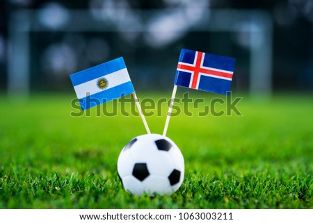 Argentina - Iceland, Group D, Saturday, 16. June, Football, World Cup, Russia 2018, National Flags on green grass, white football ball on ground. #1063003211