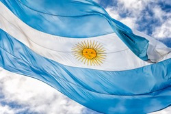 Argentine Flag Waving Against a Blue Sky on a Sunny Day in Plaza de Mayo, Buenos Aires, Argentina