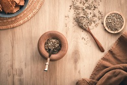 Argentine mate and yerba mate on wooden background